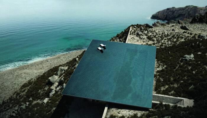 Παγκόσμια διάκριση για την καμουφλαρισμένη κατοικία με την πισίνα – καθρέφτη στην Τήνο (εικόνες)
