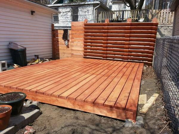 After he stained the porch, he went on to finish the yard area around the actual porch. Unfortunately, he doesn't have photos of that step because it was a surprise for his wife and he was limited on time, but the finished product...