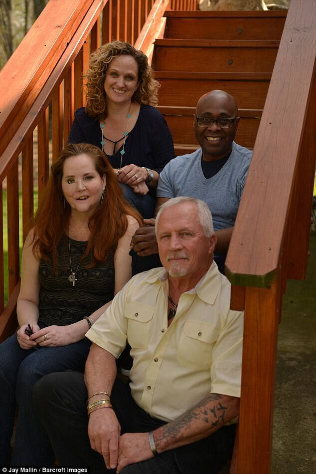 (L-R) Rebekah Kousa, Howard Daniel, suicide survivor Christen McGinnes and George Ronetz, sitting on steps, in Fairfax, Virginia