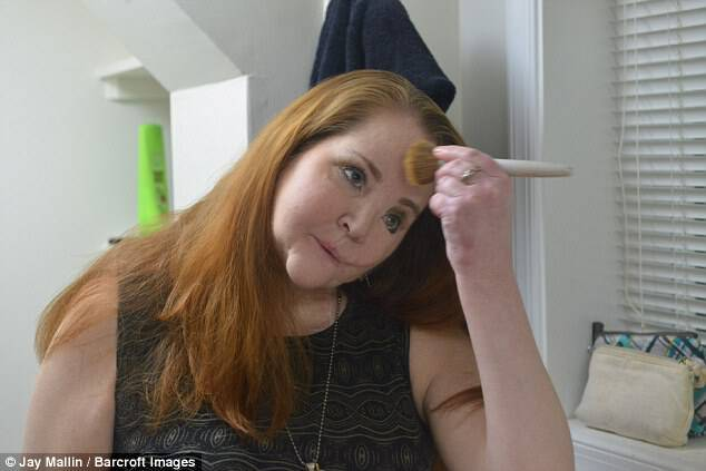 Suicide survivor Christen McGinnes doing her make up in the mirror in Fairfax, Virginia
