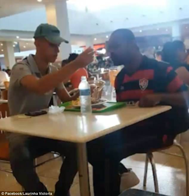 An onlooker captured the moment fast food worker helped a disabled man eat his dinner