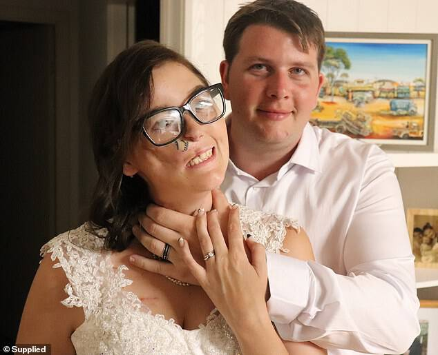The organisation, which gifts weddings to the terminally ill, provided a welcome sign, stylist, cake, photographer, videographer and celebrant (pictured with Josh)