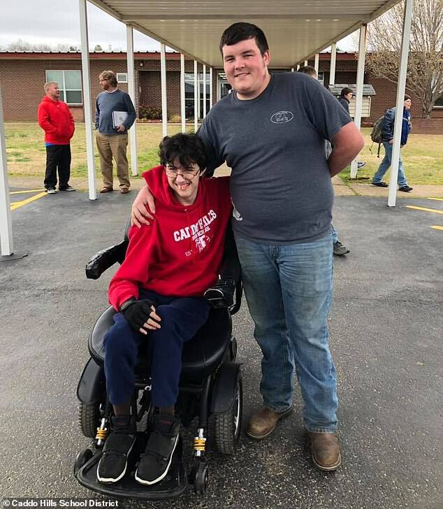 After two years of saving, Arkansas high school senior Tanner Wilson (right) gave his classmate Brandon Qualls (left) the gift of better access to mobility with an electric wheelchair