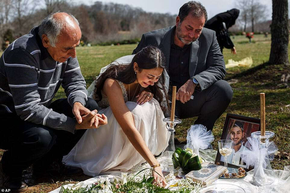 Baluch's loved ones, including her father Masoud (left) and her would-be father-in-law Mohssen Sharifi (right) joined her for a memorial at Harpeth Hills Memory Gardens in Nashville. 'We were supposed to be together,' Baluch said as tears streamed down her face