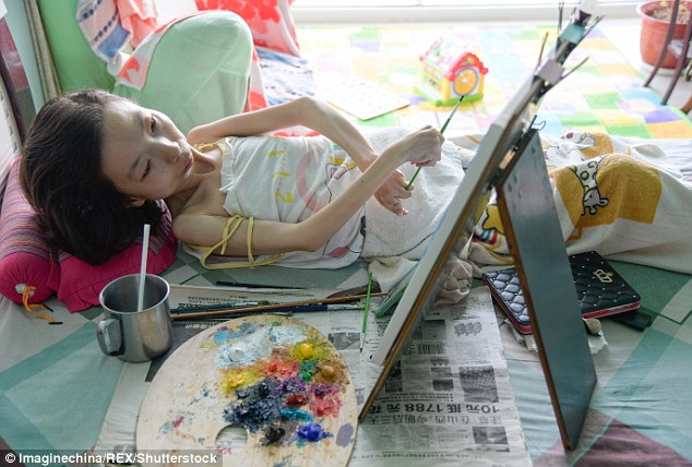 'The world is too beautiful. Even if I am in poor health, I don't want to give up the opportunity to live,' Zhang told MailOnline. She has created more than 300 paintings since 2015