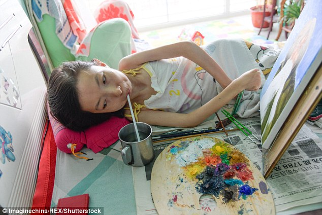 The devoted artist only stops from time to time to take a sip of water placed on her bedside